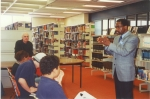 Rubin 'Hurricane' Carter at Vaughan Road Academy library, 2001  with Ken Klonsky and class